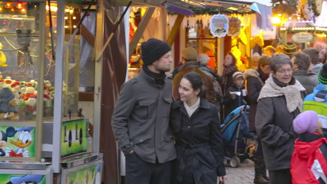 ws ts shot of couple walking along christmas market / potsdam, brandenburg, germany  - tracking shot stock videos & royalty-free footage