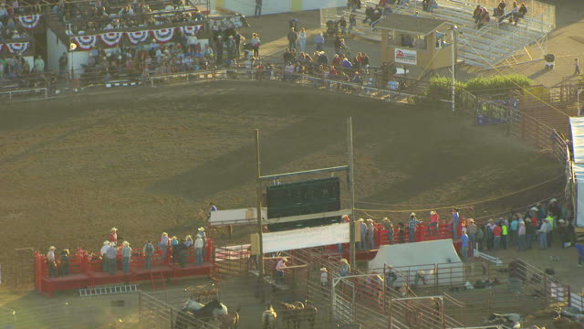 MS ZO Shot of cowboy riding horse in ring at Montana State Fair to grandstand / Montana, United States