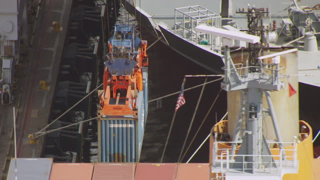 cu aerial ts shot of crane picking up large crate at port / new jersey, united states - orange new jersey stock videos & royalty-free footage