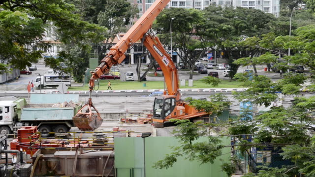 Ws Shot Of Crane Working On Road Construction Singapore