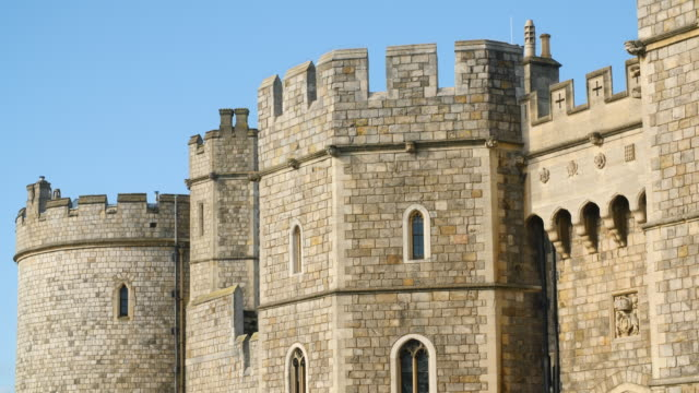 Shot of crenellations and stonework decorating the exterior of Windsor Castle.