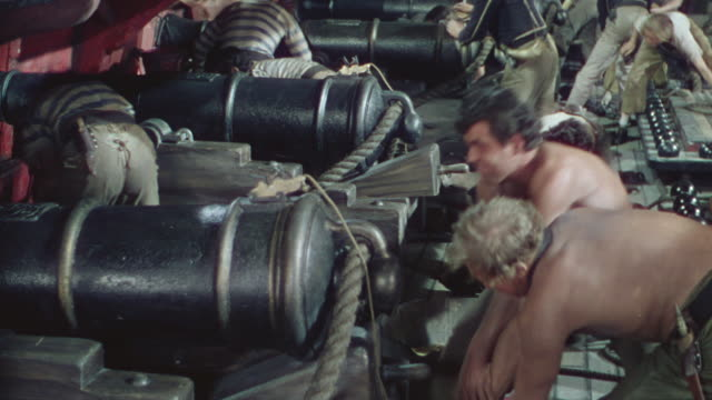 ms shot of crew preparing for fire of cannon - artillery stock videos & royalty-free footage