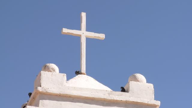 CU LA Shot of Cross on top of church / San Pedro de Atacama, Norte Grande, Chile