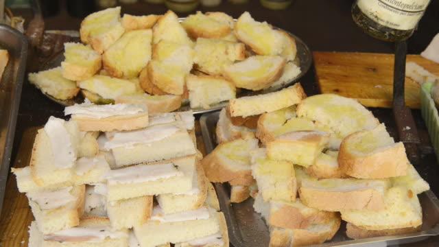 ms shot of crostini bread in delicatessen store / montepulciano, tuscany, italy - gruppo di oggetti video stock e b–roll
