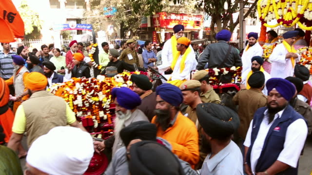 ms ts shot of crowd at nagar kirtan procession / delhi, india - religious celebration stock videos & royalty-free footage