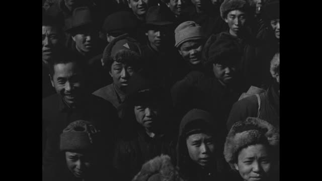 shot of crowd in shenyang around base of monument to soviet tankmen erected by soviet army / three shots of crowd of manchurian people / shot of... - chiang kai shek stock-videos und b-roll-filmmaterial