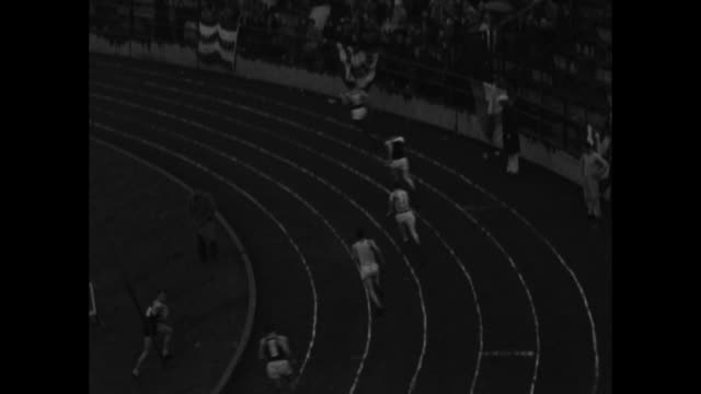 shot of crowd in stands at drake stadium during the drake relays track and field event / two shots of 440yard relay rice institute winning / men's... - men's track stock videos and b-roll footage