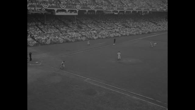 shot of crowd in stands at ebbets field site of allstar game / boston braves' pitcher warren spahn throws pitch ny yankees' joe dimaggio stands at... - basebollpitcher bildbanksvideor och videomaterial från bakom kulisserna