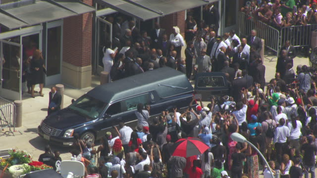 ms aerial shot of crowd of people by hearse outside friendly temple missionary baptist church / st louis, missouri, united states - baptist stock videos & royalty-free footage