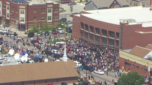 ms aerial zo shot of crowd of people by hearse outside friendly temple missionary baptist church / st louis, missouri, united states - baptist stock videos & royalty-free footage
