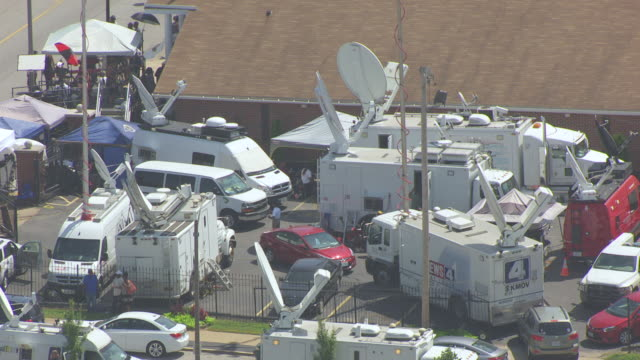 ms aerial ts shot of crowd of television station crews outside friendly temple missionary baptist church / st louis, missouri, united states - social issues video stock e b–roll