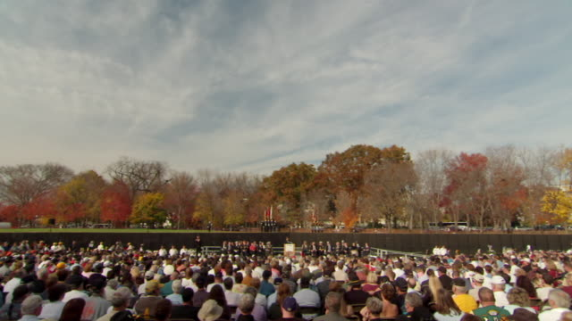 ws zi shot of crowd sitting down and listening as man on podium speaks during veterans day ceremony at vietnam veterans memorial wall / washington, district of columbia, united states - vietnam veterans memorial video stock e b–roll