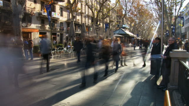 MS T/L Shot of crowd walking on street in La Rambla / Barcelona, Catalonia, Spain