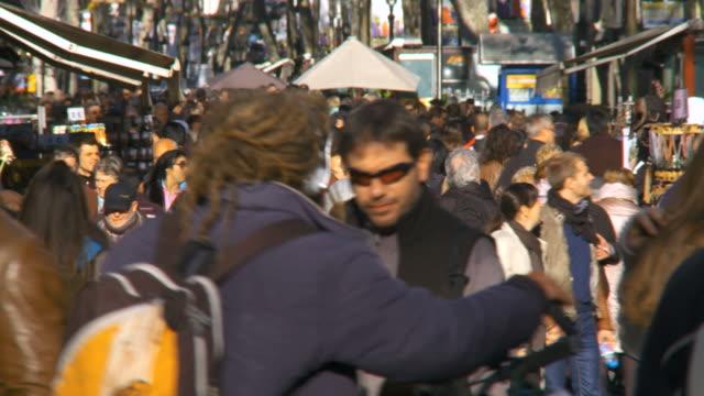 CU Shot of crowd walking on street in Las Ramblas / Barcelona, Catalonia, Spain