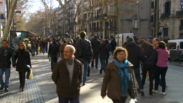 MS TD Shot of crowd walking on street in Las Ramblas / Barcelona, Catalonia, Spain