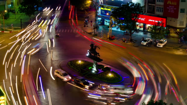 ms t/l pan shot of crowded area in city at night / ho chi minh city, vietnam - vietnam meridionale video stock e b–roll