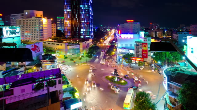 ms t/l zo shot of crowded area in city at night / ho chi minh city, vietnam - vietnam meridionale video stock e b–roll