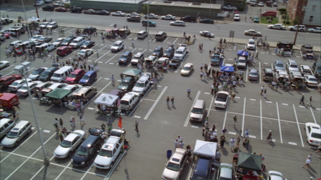 WS PAN Shot of crowded parking lot / Unspecified