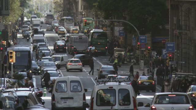 ms shot of crowded street with people and traffic / barcelona, catalunya, spain - barcellona spagna video stock e b–roll