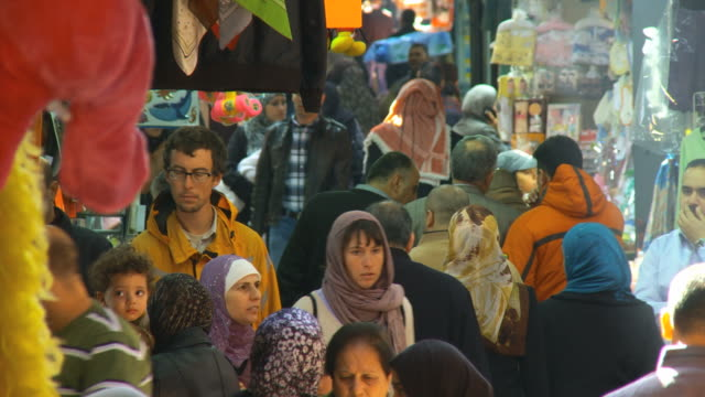 MS Shot of crowds at Muslim Quarter streets in old city / Jerusalem, Judea, Israel