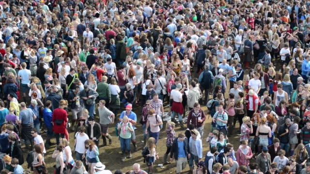 MS Shot of Crowds departing at end of performance at summer music festival / United Kingdom