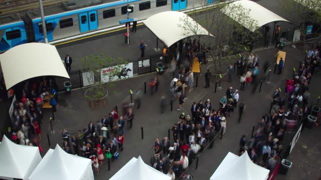 MS T/L HA PAN Shot of Crowds exiting trains / Melbourne, Victoria, Australia