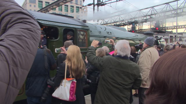 shot of crowds filming the arrival of the flying scotsman into london's king cross station on their phones - railway station stock videos & royalty-free footage