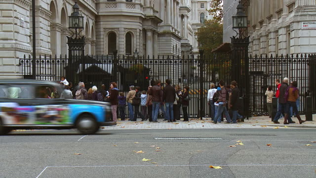 ms t/l shot of crowds gather outside downing street in london / london, united kingdom  - downing street stock videos & royalty-free footage