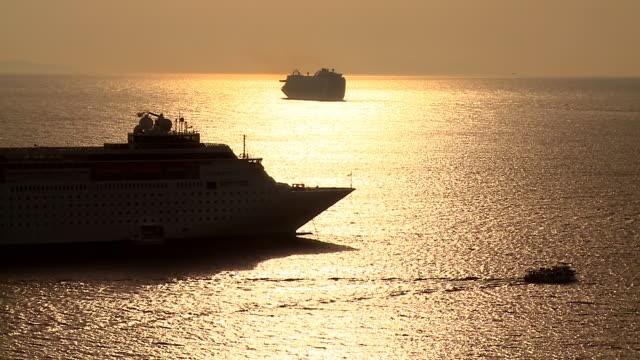 ms shot of cruise ship at sunset / mykonos, cyclades, greece - mykonos stock videos and b-roll footage