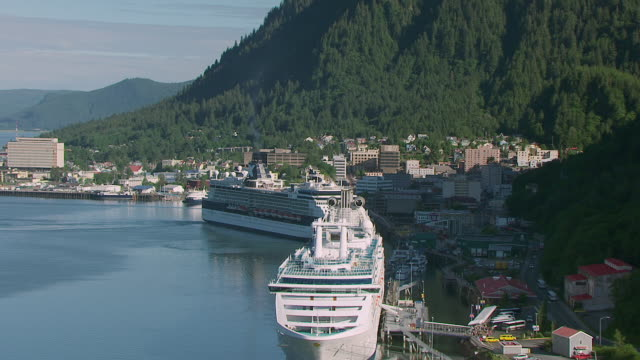 ws aerial shot of cruise ships at port and rotate to reveal harbor / juneau, alaska, united states - juneau stock videos and b-roll footage