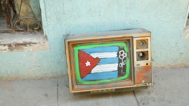 cu shot of cuban flag on tv / cuba  - socialism stock videos & royalty-free footage