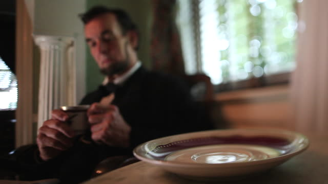 ms shot of cup in focus and president lincoln reaches for cup takes sip and puts it back / clear spring, maryland, united states - civil war stock videos & royalty-free footage