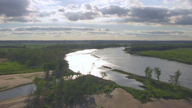 MS AERIAL Shot of Curve of Missouri River with reflecting sun / Nebraska, United States