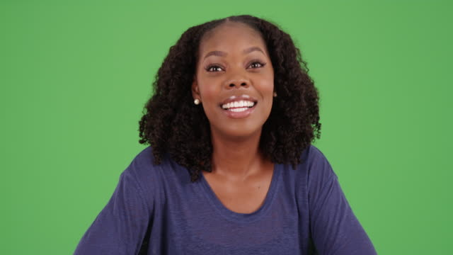 pov shot of cute black woman with curly hair video chatting on green screen - conference call stock videos & royalty-free footage