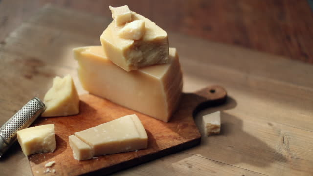 shot of cutting cheese with knife - cheese stock videos & royalty-free footage