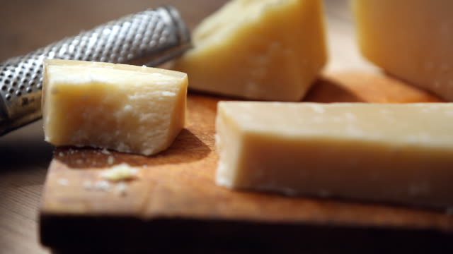 Shot of cutting cheese with knife