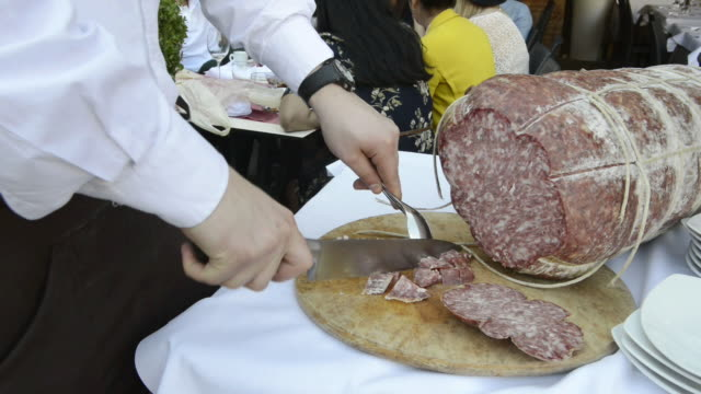 cu shot of cutting salami in restaurant / siena, tuscany, italy - siena italy stock videos and b-roll footage