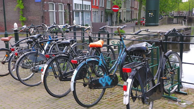 MS Shot of cycle stand  at canal at Turfsingel, Gouda / Gouda, South Holland, Netherlands