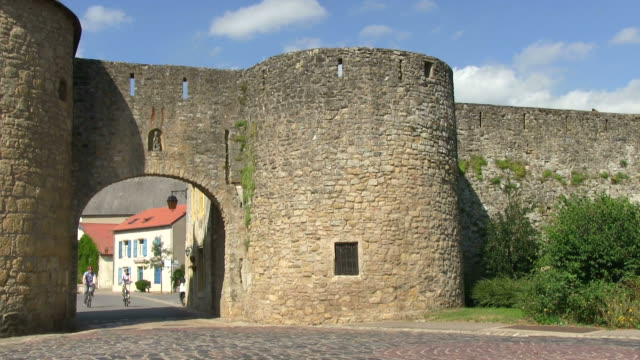 ms shot of cyclists at old town / rodemack, lorraine, france - lorraine stock videos & royalty-free footage