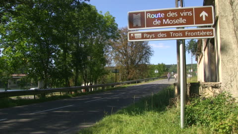 ms pan shot of cyclists near moselle / contz-les-bains, lorraine, france - lorraine stock-videos und b-roll-filmmaterial