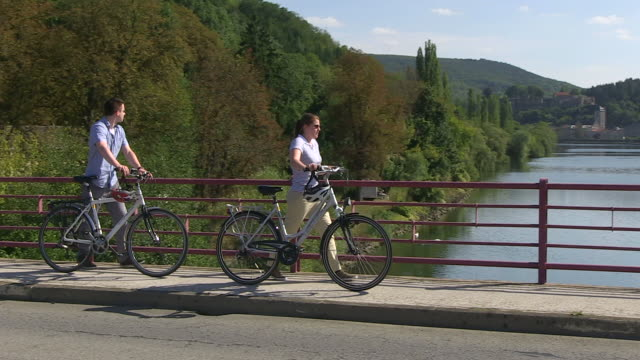ms ts shot of cyclists on bridge near moselle / contz-les-bains, lorraine, france - lorraine stock videos & royalty-free footage