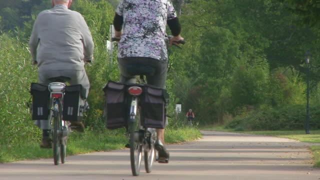ms shot of cyclists on street / saarburg, rhineland palatinate, germany - saarburg stock-videos und b-roll-filmmaterial