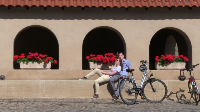 ms shot of cyclists sitting at old town / rodemack, lorraine, france - lorraine stock videos & royalty-free footage