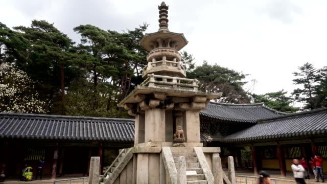 shot of dabotap(korea national treasure) and tourists at bulguksa(unesco world heritage site) - besichtigung stock-videos und b-roll-filmmaterial
