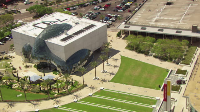 MS AERIAL ZO Shot of Dali Museum entrance with visitors and building / St Petersburg, Florida, United States