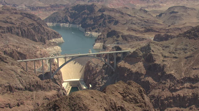 ms aerial shot of dam and bypass with rocky mountains surrounding hoover dam / nevada, united states - lake mead video stock e b–roll