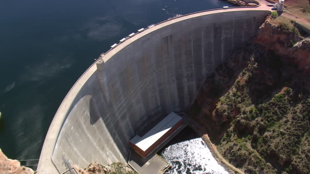 MS AERIAL TD Shot of Dam in river with pwer station / Montana, United States