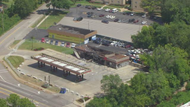 WS AERIAL Shot of damaged Quiktrip Market and gas station in Ferguson / St Louis, Missouri, United States