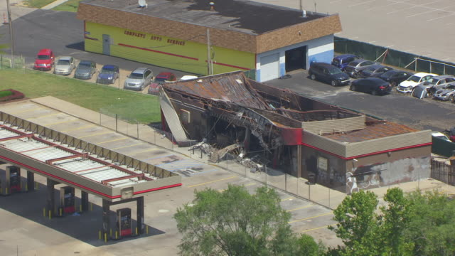 MS AERIAL Shot of damaged Quiktrip Market and gas station in Ferguson / St Louis, Missouri, United States