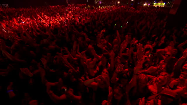 ms ha pov zi zo shot of dancing crowd covering in red light hands up in air / isle of wight, london, united kingdom - red stock videos & royalty-free footage